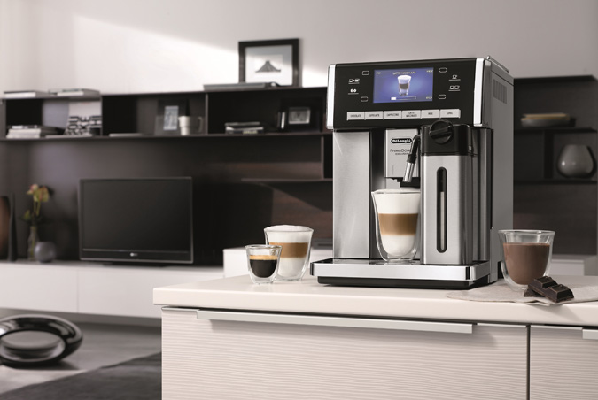 DeLonghi PrimaDonna Exclusive ESAM 6900, first coffee maker making hot chocolate