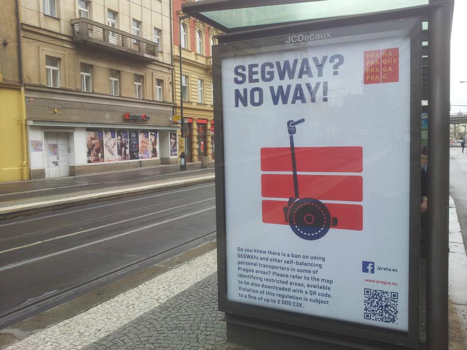 Poster at Bílá Labuť tram stop \ Photo: Dave Park