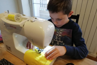 Kaja, age 8 is helping to sew masks for his friends and neighbors (photo by Angel Prince)