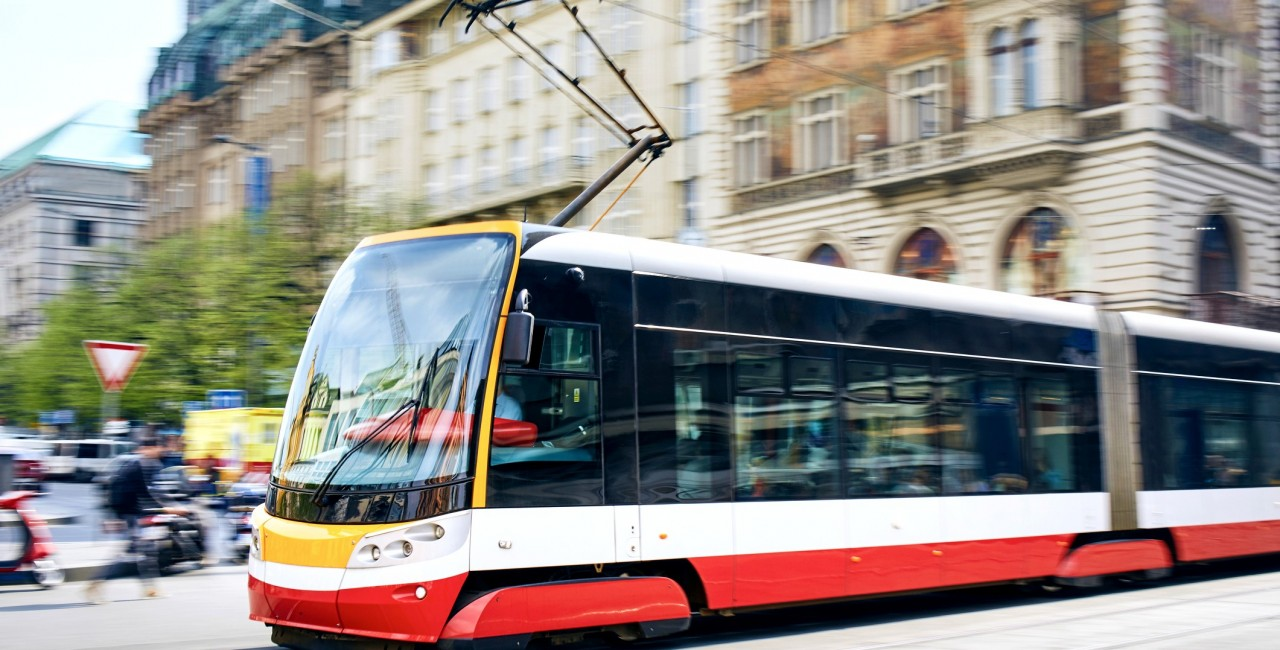 Daily life in the city. Modern tram of public transportation in blurred motion. Traffic at Wenceslas Square, Prague, Czech Republi