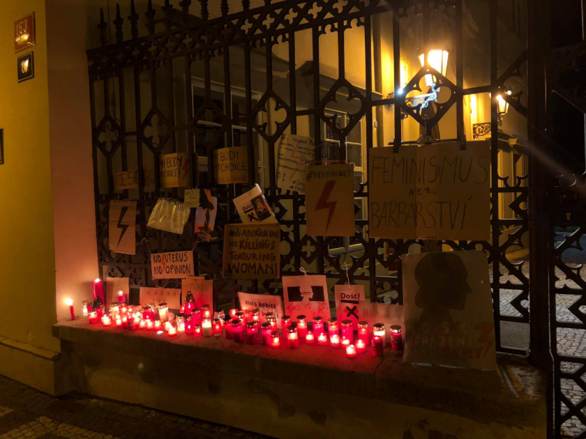 Candles in signs outside the Polish Embassy in Prague