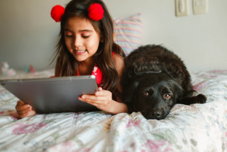 girls with tablet and dog
