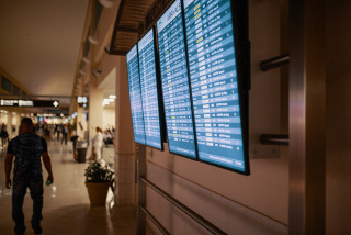 A departures board at an airport. (photo: Pexels)