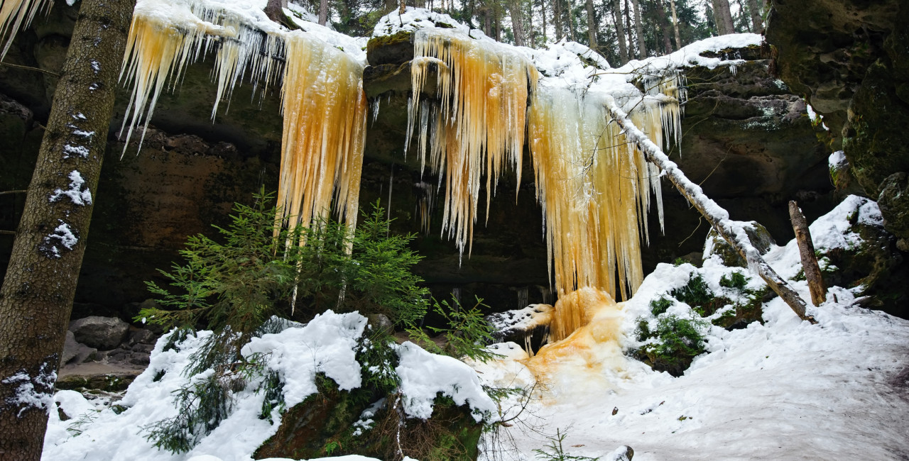 Colorful ice formations in the Czech Republic via iStock / OndrejVladyka