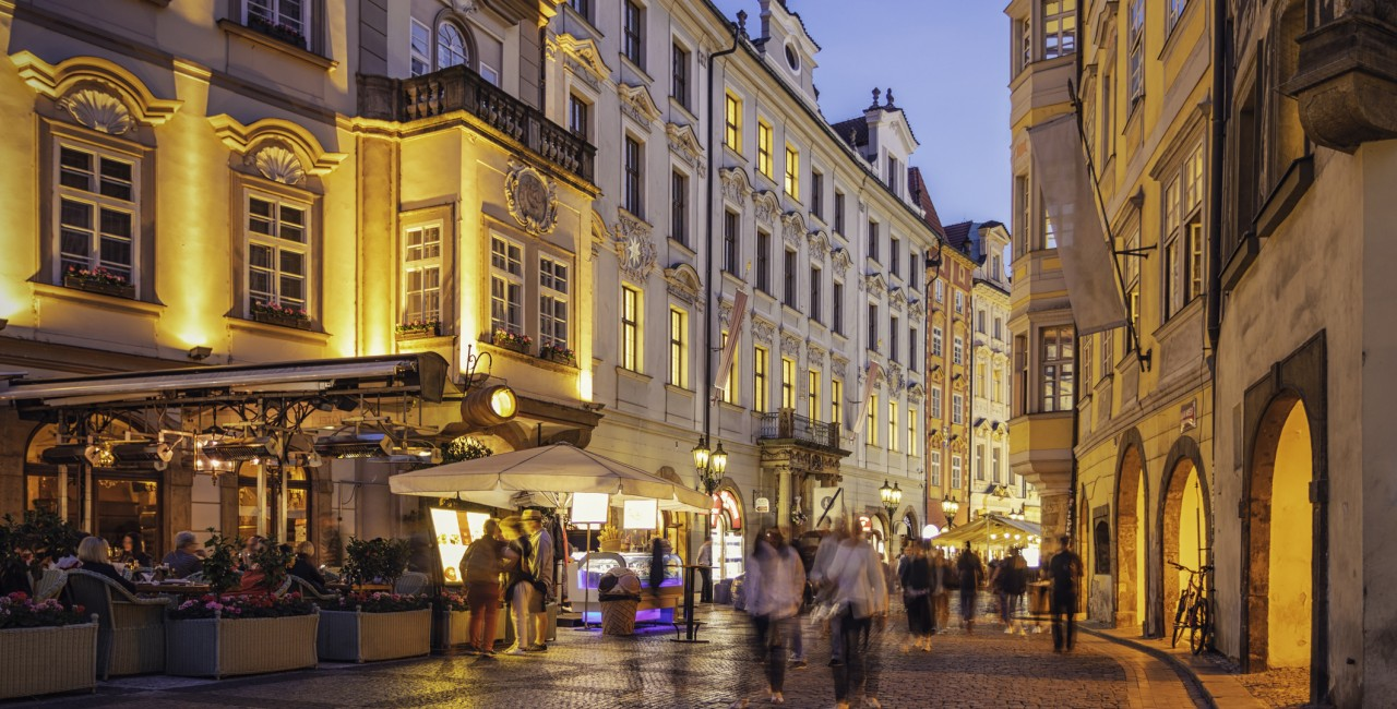 Tourists walking down a street in Prague in the evening. (Photo: iStock, Marcus Lindstrom)